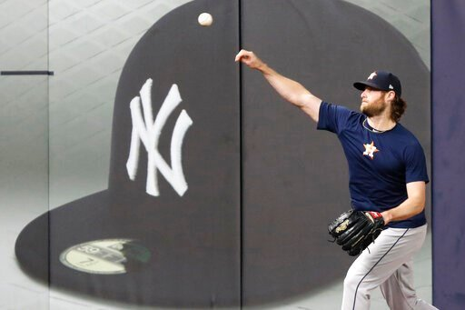 (AP Photo/Kathy Willens). Houston Astros Game 3 starting pitcher Gerrit Cole throws on the field at Yankee Stadium, Monday, Oct. 14, 2019, in New York, after the team arrived to prepare for the American League Championship Series which continues Tuesda...