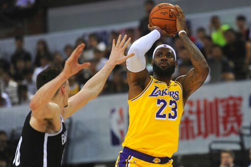 (Color China Photo via AP). Los Angeles Lakers' LeBron James in action during a match against Brooklyn Nets at the NBA China Games 2019 in Shenzhen in south China's Guangdong province on Saturday, Oct. 12, 2019