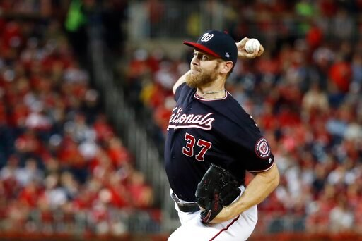 (AP Photo/Jeff Roberson). Washington Nationals starting pitcher Stephen Strasburg throws during the first inning of Game 3 of the baseball National League Championship Series against the St. Louis Cardinals Monday, Oct. 14, 2019, in Washington.