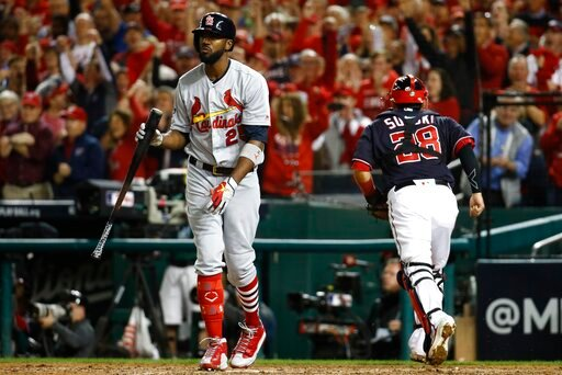 (AP Photo/Patrick Semansky). St. Louis Cardinals' Dexter Fowler reacts after striking out during the seventh inning of Game 3 of the baseball National League Championship Series against the Washington Nationals Monday, Oct. 14, 2019, in Washington.