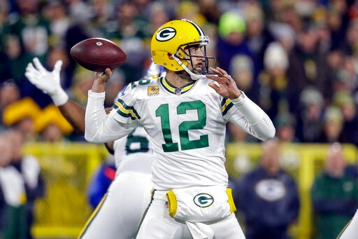 (AP Photo/Jeffrey Phelps). Green Bay Packers quarterback Aaron Rodgers drops back to pass during the first half of an NFL football game against the Detroit Lions, Monday, Oct. 14, 2019, in Green Bay, Wis.