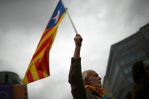 (AP Photo/Francisco Seco). A man waves an Estelada pro Catalonia independence flag during a protest in Brussels, Tuesday, Oct. 15, 2019. New disruptions to Catalonia's transportation network on Tuesday followed a night of clashes between activists and ...
