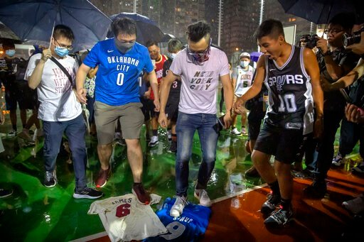 (AP Photo/Mark Schiefelbein). Demonstrators stamp on Lebron James jerseys during a rally at the Southorn Playground in Hong Kong, Tuesday, Oct. 15, 2019. Protesters in Hong Kong have thrown basketballs at a photo of LeBron James and chanted their anger...