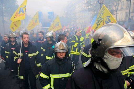 (AP Photo/Michel Euler). Firemen march as they protest with hospital staff on wages, working conditions and pensions, Tuesday, Oct. 15, 2019 in Paris.
