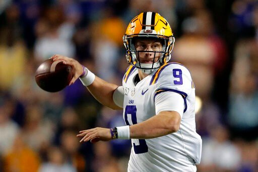 (AP Photo/Gerald Herbert). FILE - In this Oct. 12, 2019, file photo, LSU quarterback Joe Burrow (9) passes in the second half of an NCAA college football game against Florida, in Baton Rouge, La. Burrow was selected to the AP Midseason All-America NCAA...