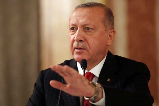 """(Presidential Press Service via AP, Pool). Turkey's President Recep Tayyip Erdogan addresses a conference of parliament speakers in Istanbul, Friday, Oct. 11, 2019. Erdogan says his county """"will not take a step back"""" from its offensive against Syrian K..."""
