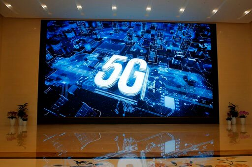 (AP Photo/Kin Cheung, File). In this March 6, 2019, photo, a 5G logo is displayed on a screen outside the showroom at Huawei campus in Shenzhen city, China's Guangdong province. Australia's ban on Chinese telecoms giant Huawei's involvement in its futu...