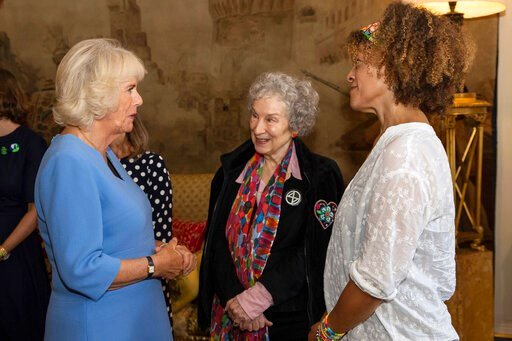 (Aaron Chown/PA via AP). Britain's Camila The Duchess of Cornwall talks with 2019 Booker prize joint winners Margaret Atwood, centre, and Bernardine Evaristo, right, during a reception for the Booker Prize Foundation at Clarence House in London, Tuesda...