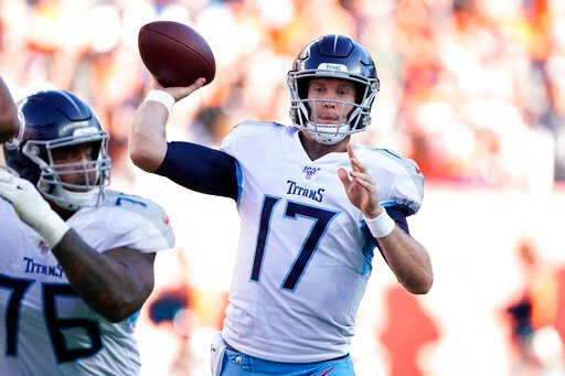 (AP Photo/Jack Dempsey). Tennessee Titans quarterback Ryan Tannehill throws a pass during the second half of an NFL football game against the Denver Broncos, Sunday, Oct. 13, 2019, in Denver.