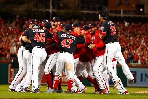 (AP Photo/Jeff Roberson). The Washington Nationals celebrate after Game 4 of the baseball National League Championship Series Tuesday, Oct. 15, 2019, in Washington. The Nationals won 7-4 to win the series 4-0.