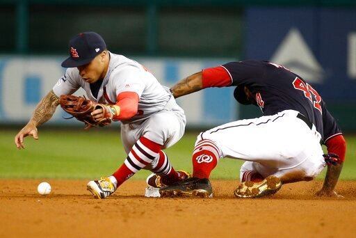 (AP Photo/Patrick Semansky). Washington Nationals' Howie Kendrick is safe at second as St. Louis Cardinals' Kolten Wong can't handle the ball during the first inning of Game 4 of the baseball National League Championship Series Tuesday, Oct. 15, 2019, ...