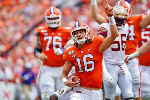 (AP Photo/Richard Shiro). Clemson quarterback Trevor Lawrence (16) reacts after scoring a touchdown during the first half of an NCAA college football game against Florida State, Saturday, Oct. 12, 2019, in Clemson, S.C.