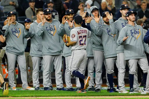 (AP Photo/Matt Slocum). Houston Astros second baseman Jose Altuve celebrates with teammates after their 4-1 win against the New York Yankees in Game 3 of baseball's American League Championship Series Tuesday, Oct. 15, 2019, in New York.