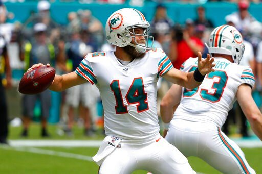 (AP Photo/Wilfredo Lee, File). FILE - In this Sept. 15, 2019, file photo, Miami Dolphins quarterback Ryan Fitzpatrick (14) looks to pass during the first half at an NFL football game against the New England Patriots, in Miami Gardens, Fla. Ryan Fitzpat...