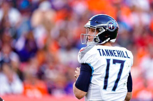 (AP Photo/Jack Dempsey). Tennessee Titans quarterback Ryan Tannehill looks to throw a pass during the second half of an NFL football game against the Denver Broncos, Sunday, Oct. 13, 2019, in Denver.