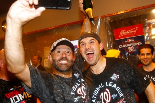 (AP Photo/Patrick Semansky). Washington Nationals' Ryan Zimmerman and Dr. Hirad Bagy celebrate after Game 4 of the baseball National League Championship Series against the St. Louis Cardinals Wednesday, Oct. 16, 2019, in Washington. The Nationals won 7...