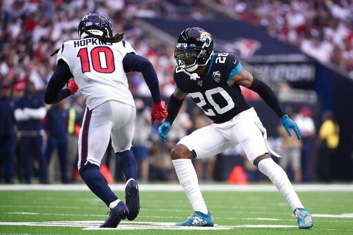 (AP Photo/Eric Christian Smith, File). FILE - In this Sunday, Sept. 15, 2019 file photo, Houston Texans wide receiver DeAndre Hopkins (10) runs around Jacksonville Jaguars cornerback Jalen Ramsey (20) during the second half of an NFL football game in H...