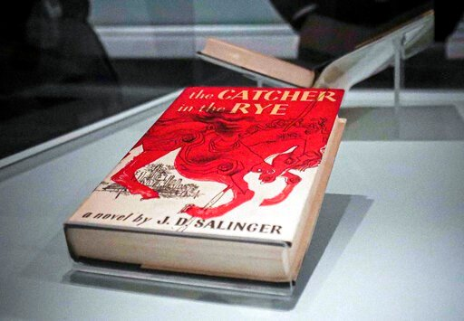 "(AP Photo/Bebeto Matthews). A copy of the 1951 novel ""The Catcher in the Rye"" is part of a J.D. Salinger exhibit being installed at the New York Public Library, Wednesday, Oct. 16, 2019, in New York. The exhibit, titled ""JD Salinger,"" opens Friday and ..."