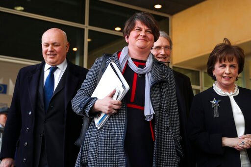 (AP Photo/Francisco Seco, File). FILE - In this Thursday, April 11, 2019 file photo, Northern Ireland Democratic Unionist Party leader Arlene Foster, center, speaks to journalists after her meeting with European Union chief Brexit negotiator Michel Bar...