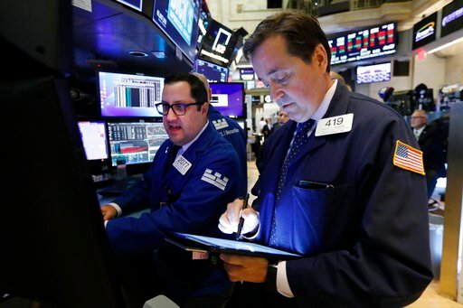 (AP Photo/Richard Drew, File). FILE - In this Oct. 8, 2019, file photo specialist Brian Fairbrother, left, and trader Philip Powers work on the floor of the New York Stock Exchange. The U.S. stock market opens at 9:30 a.m. EDT on Thursday, Oct. 17.