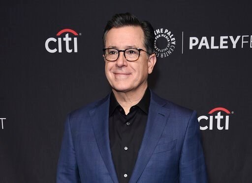 "(Photo by Richard Shotwell/Invision/AP, File). FILE - This March 16, 2019 file photo shows Stephen Colbert at the 36th Annual PaleyFest ""An Evening with Stephen Colbert"" event in Los Angeles. CBS announced Thursday that Colbert has signed a new contrac..."