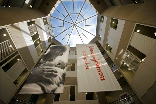 (AP Photo/Mel Evans, File). FILE - In this July 30, 2013, file photo, large banners hang in an atrium at the headquarters of Johnson & Johnson in New Brunswick, N.J.  Johnson & Johnson has agreed to a $117 million multistate settlement over all...