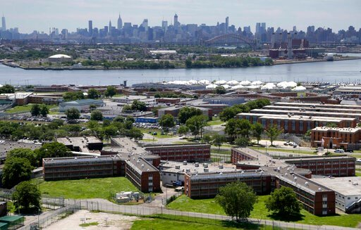 (AP Photo/Seth Wenig, File). FILE - This June 20, 2014 file photo shows the Rikers Island jail complex in New York with the Manhattan skyline in the background. New York City lawmakers are considering a plan to close the notorious Rikers Island jail co...