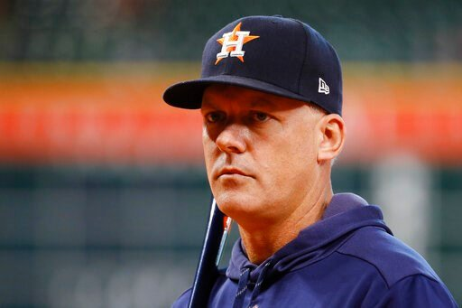 (AP Photo/Matt Slocum). Houston Astros manager AJ Hinch watches during batting practice before Game 1 of baseball's American League Championship Series against the New York Yankees Saturday, Oct. 12, 2019, in Houston.