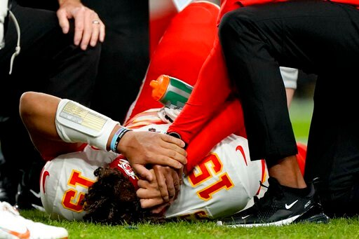 (AP Photo/Jack Dempsey). Kansas City Chiefs quarterback Patrick Mahomes (15) is helped by trainers after getting injured against the Denver Broncos during the first half of an NFL football game, Thursday, Oct. 17, 2019, in Denver.