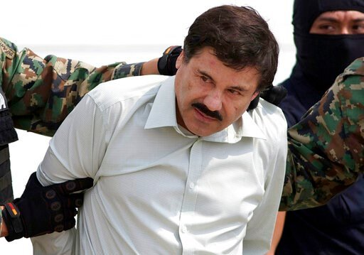 """(AP Photo/Eduardo Verdugo, File). FILE - In this Feb. 22, 2014 file photo, Joaquin """"El Chapo"""" Guzman, the head of Mexico's Sinaloa Cartel, is escorted to a helicopter in Mexico City following his capture in the beach resort town of Mazatlan, Mexico. An..."""