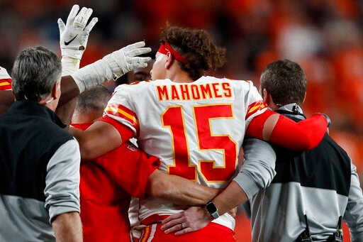 (AP Photo/David Zalubowski). Kansas City Chiefs quarterback Patrick Mahomes (15) leaves the game after getting injured against the Denver Broncos during the first half of an NFL football game, Thursday, Oct. 17, 2019, in Denver.