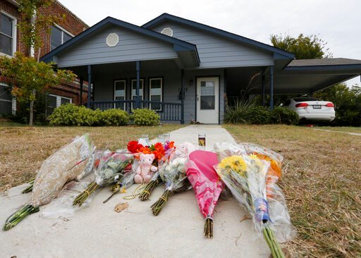 (AP Photo/David Kent, File). FILE - In this Monday, Oct. 14, 2019 photo, flowers lie on the sidewalk in front of the house in Fort Worth, Texas, where a white Fort Worth police officer Aaron Dean shot and killed Atatiana Jefferson, a black woman, throu...