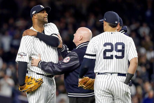 (AP Photo/Frank Franklin II). New York Yankees trainer Steve Donohue, center, checks on pitcher CC Sabathia during the eighth inning of Game 4 of baseball's American League Championship Series against the Houston Astros, Thursday, Oct. 17, 2019, in New...