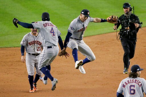 (AP Photo/Seth Wenig). Houston Astros center fielder George Springer (4) and shortstop Carlos Correa (1) celebrate after the Astros beat the New York Yankees 8-3 in Game 4 of baseball's American League Championship Series, Friday, Oct. 18, 2019, in New...