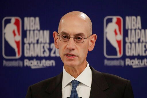 (AP Photo/Jae C. Hong). FILE - In this Oct. 8, 2019 file photo, NBA Commissioner Adam Silver speaks at a news conference before an NBA preseason basketball game between the Houston Rockets and the Toronto Raptors in Saitama, near Tokyo. When major corp...