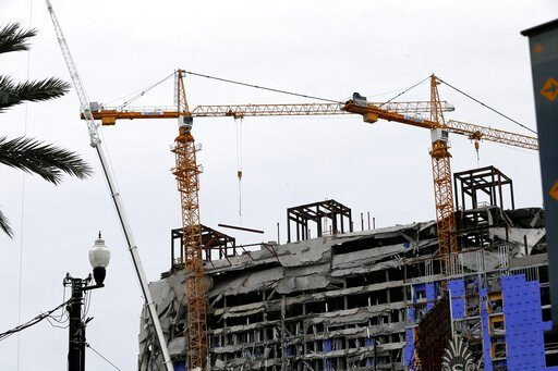 (AP Photo/Gerald Herbert). Two unstable cranes loom over the construction of a Hard Rock Hotel, Thursday, Oct. 17, 2019, in New Orleans.  The 18-story hotel project that was under construction collapsed last Saturday, killing three workers. Two bodies ...