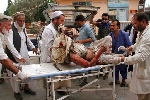 (AP Photo/Wali Sabawoon). A wounded man is brought by stretcher into a hospital after a mortar was fired by insurgents in Haskamena district of Jalalabad east of Kabul, Afghanistan, Friday, Oct. 18, 2019. An Afghan official says at least several people...