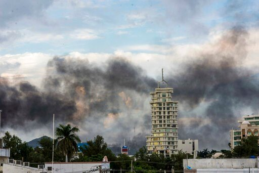 (AP Photo/Hector Parra). Smoke from burning cars rises due in Culiacan, Mexico, Thursday, Oct. 17, 2019. An intense gunfight with heavy weapons and burning vehicles blocking roads raged in the capital of Mexico's Sinaloa state Thursday after security f...