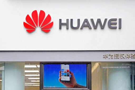 (AP Photo/Kin Cheung, File). FILE - In this March 7, 2019 file photo, a logo of Huawei is displayed at a shop in Shenzhen, China's Guangdong province. Chinese tech giant Huawei has reported a double-digit rise in sales despite U.S. sanctions that threa...
