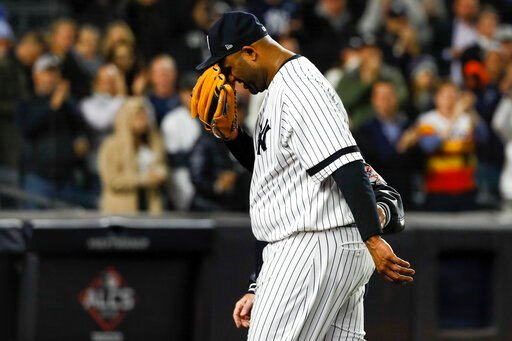 (AP Photo/Matt Slocum). New York Yankees pitcher CC Sabathia is helped off the field during the eighth inning in Game 4 of baseball's American League Championship Series against the Houston Astros Thursday, Oct. 17, 2019, in New York.