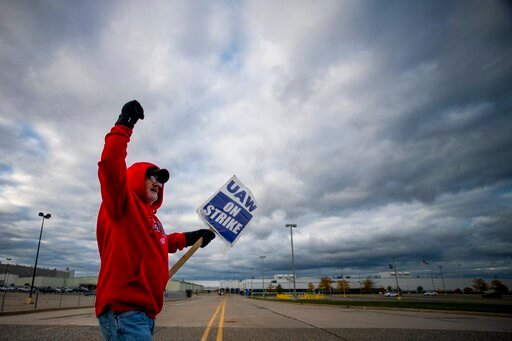(Jake May/The Flint Journal via AP). Jimmy Mangrym, a 63-year-old Flint native who has 43 years in at Flint Metal Fabrication in tool and dye, circle in front of an entrance to Flint Engine Operations as UAW members line the street with picket signs on...