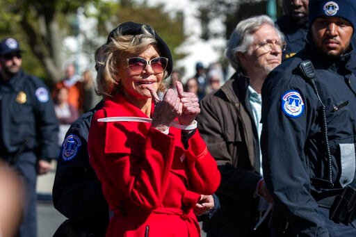 (AP Photo/Manuel Balce Ceneta). Actress Jane Fonda gestures after being arrested during a rally on Capitol Hill in Washington, Friday, Oct. 18, 2019. A half-century after throwing her attention-getting celebrity status into Vietnam War protests, Fonda ...