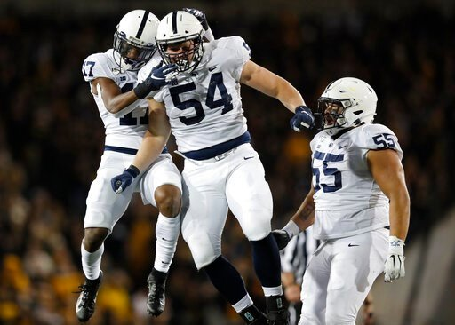 (AP Photo/Matthew Putney). Penn State defensive tackle Robert Windsor, center, celebrates a sack with safety Garrett Taylor, left, and defensive tackle Antonio Shelton, right, during the second half of an NCAA college football game against Iowa, Saturd...
