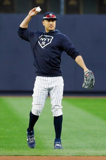 (AP Photo/Matt Slocum). New York Yankees left fielder Giancarlo Stanton warms up during batting practice before Game 4 of baseball's American League Championship Series against the Houston Astros Thursday, Oct. 17, 2019, in New York.