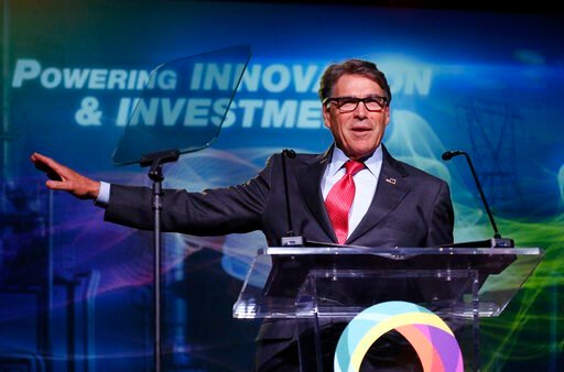 (AP Photo/Rick Bowmer, File). FILE - In this May 30, 2019, file photo,  Energy Secretary Rick Perry speaks at an energy summit in Salt Lake City. A business executive Perry recommended as an adviser to Ukraine's government exaggerated his military cred...