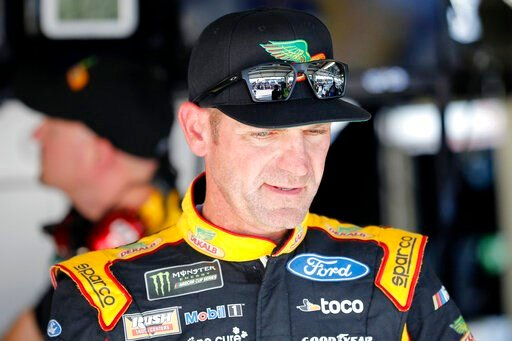 (AP Photo/Colin E. Braley). Clint Bowyer walks from the garage area following practice for a NASCAR Cup Series auto race at Kansas Speedway in Kansas City, Kan., Friday, Oct. 18, 2019.