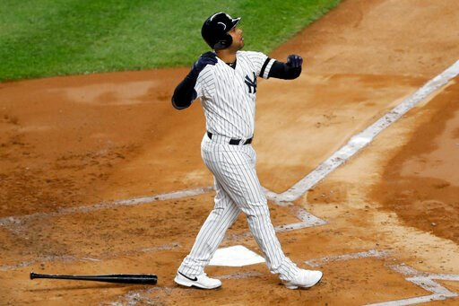 (AP Photo/Kathy Willens). New York Yankees' Aaron Hicks watches his three-run home run against the Houston Astros during the first inning in Game 5 of baseball's American League Championship Series Friday, Oct. 18, 2019, in New York.