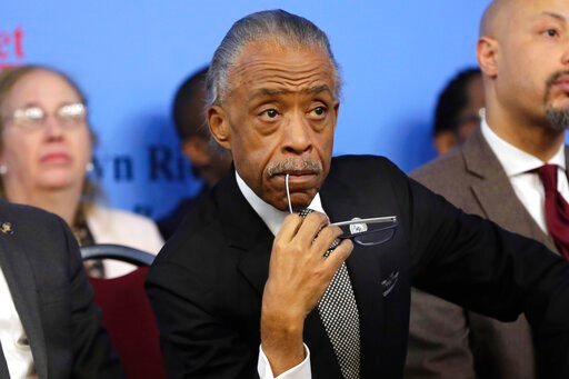 (AP Photo/Richard Drew, File). FILE - In this Monday, Jan. 15, 2018 file photo, Rev. Al Sharpton listens to remarks at the National Action Network House of Justice, in New York. A life taken at the hands of police. A grieving family. A divided nation. ...