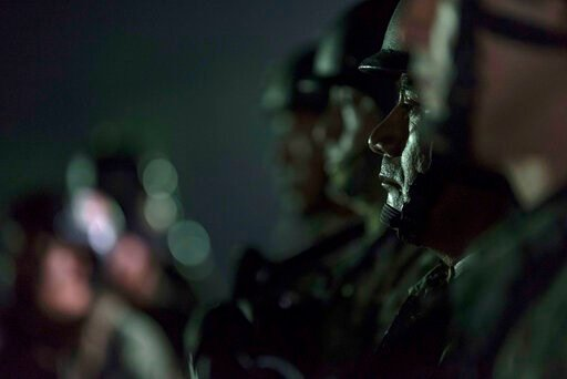 (AP Photo/Augusto Zurita). Mexican troops arrive at a military base in Culiacan, Mexico, Friday, Oct. 18, 2019. On Friday, the defense department announced it was flying two planeloads with army special forces troops into Culiacan as reinforcements. A ...