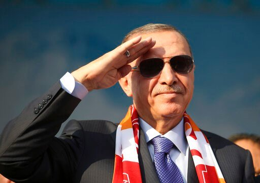 (Presidential Press Service via AP, Pool ). Turkish President Recep Tayyip Erdogan gives a military style salute toward his supporters during a rally in Kayseri, Turkey, Saturday, Oct. 19, 2019. Turkish Red Crescent says it has delivered humanitarian a...